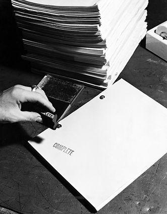 Closeup of hand stamping movie script.jp