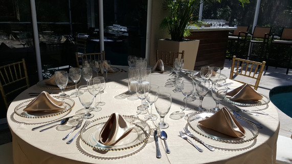 Beautiful gold table setting at a private party.