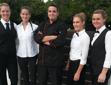 Chef Mike and his team pose for a picture in uniform.