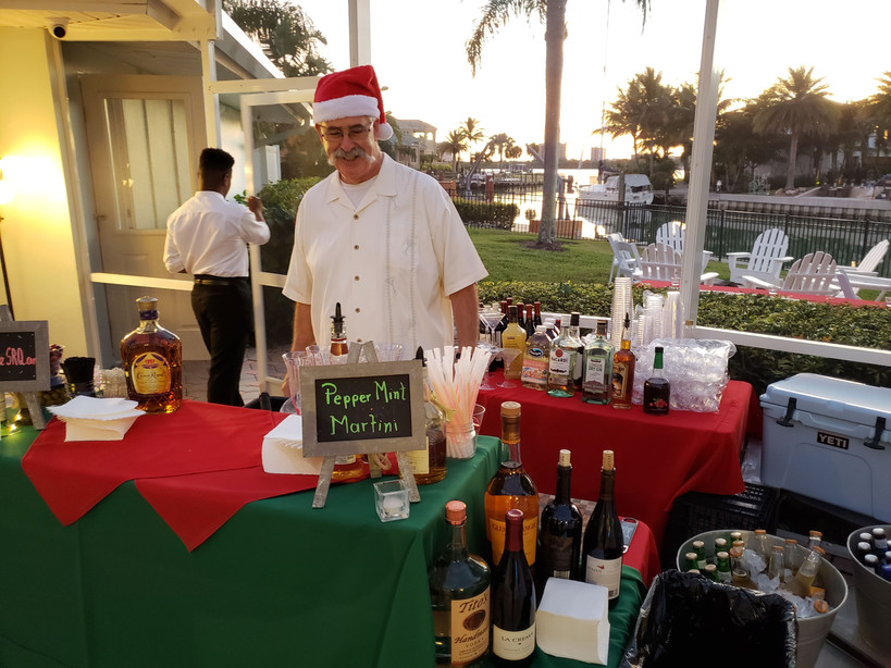 Bartender at a Christmas themed event.