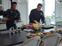 A filmcrew member of MTV's Siesta Key tv show points the camera towards Chef Mike Donnerstag's expert cooking skills.