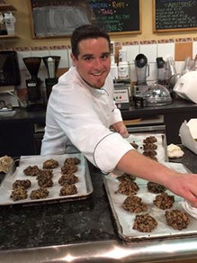 Chef Mike cheerfully bakes delicious pastries.
