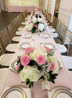 Place settings for a pink and white wedding.