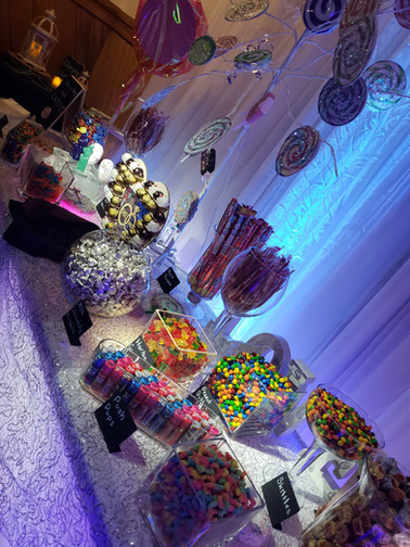 Unique candy buffet display at a candy themed party.