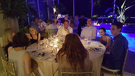 Guests sit around a table at a beautiful banquet event.