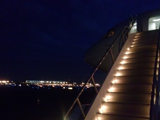 Ramp leading up to the airplane door at night.