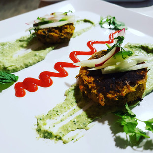 A play on contrasting red and green colors, this food presentation captures the eye and the stomach.