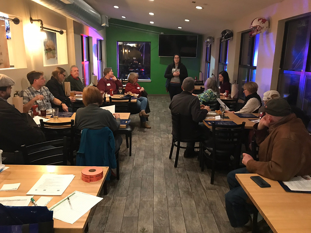 CHNA Treasurer Jayme speaks to residents at the November 7, 2019 meeting at JC's Burger Bar.