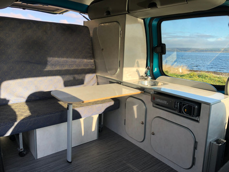 Micro Camper interior with rock and roll bed & kitchenette
