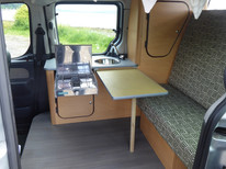 Interior with rock and roll bed, gas hob and sink unit