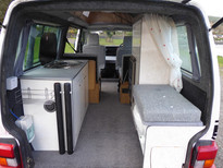 Rear kitchennette, storage and hidden chemical toilet