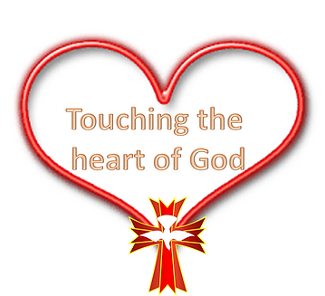 "Red heart with the words ""Touching the Heart of God"" inside"