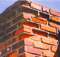 A chimney with water damage to the brick