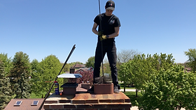 A chimney sweep sweeping a chimney
