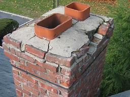 Broken chimney crown and broken brick and mortar