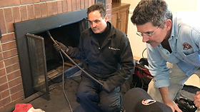 A customer watching a video chimney inspection