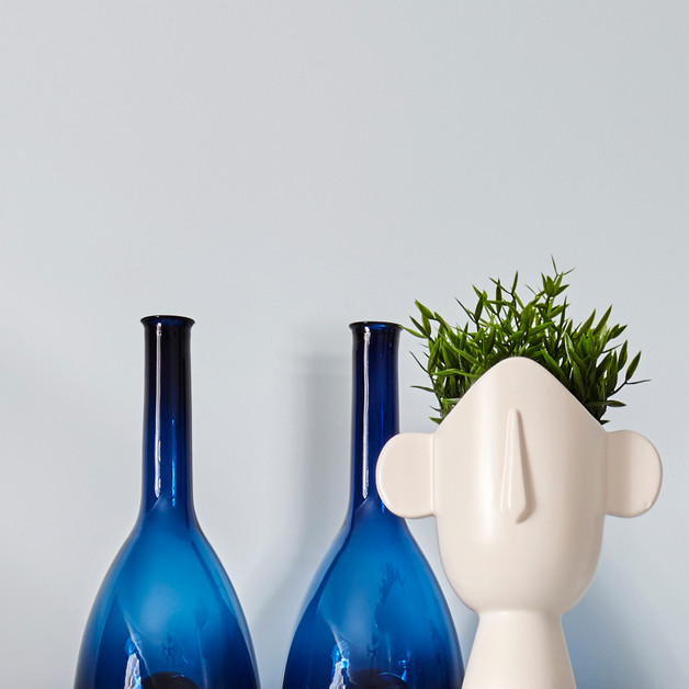 Accessory detail, statement pair of cobalt vases paired against the quirky flower pot head add interest to the black & white sideboard and create height to the space   Photography by www.patricksteel.co.uk