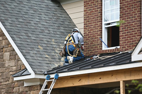 A roofer repairing a storm damaged roof