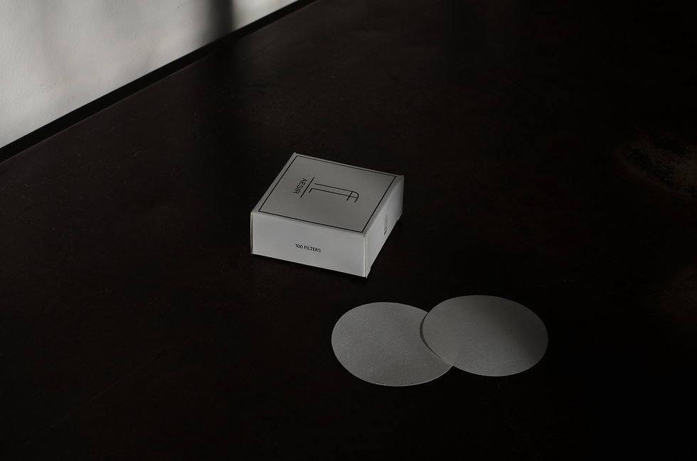 Box of Aesir filters on a metal table, with our logo
