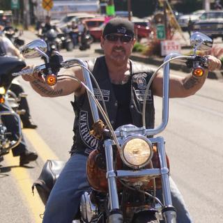 Brian On Motorcycle Smiling Natl Leaders