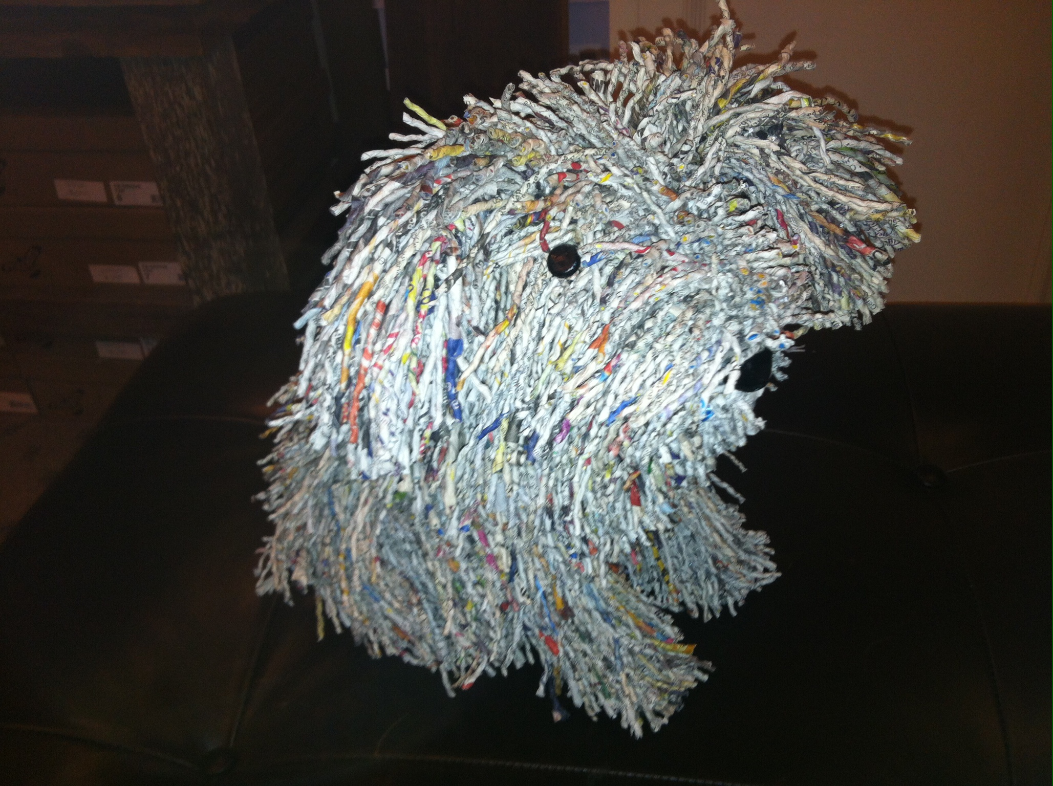 Dog made of twisted book and magazine pages