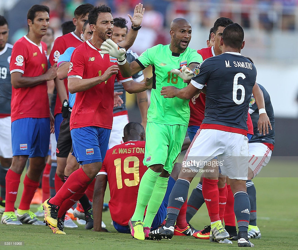 Costa Rica's Patrick Pemberton (18) and Paraguay's Miguel Samudio (6) are in the middle of a scuffle involving several players from both teams during the start of pool play in the Copa America at Camping World Stadium in Orlando, Fla., on Saturday, June 4, 2016. The teams tied, 0-0. (Stephen M. Dowell/Orlando Sentinel/TNS)