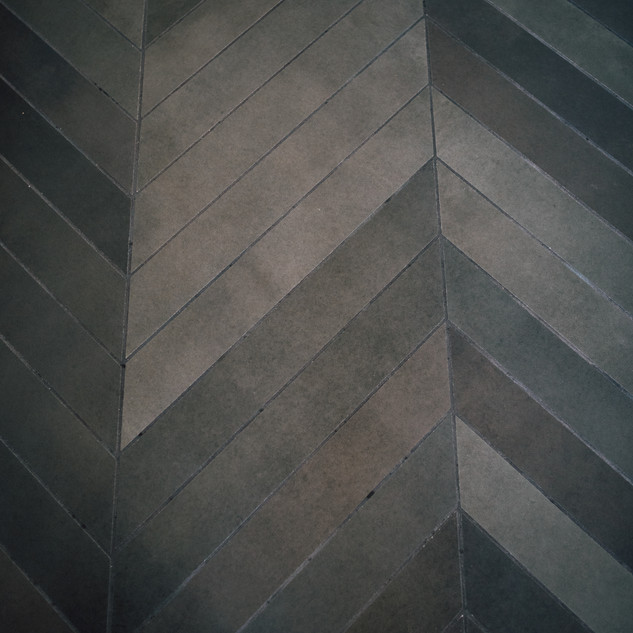 Chevron floor tiles with various shades