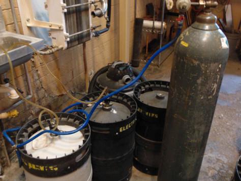 Emptying plastic kegs.