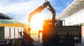 mobile crane lifting generator, silhouet