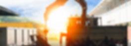 mobile crane lifting generator, silhouettes at sunset.jpg