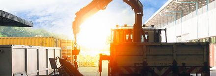 mobile crane lifting generator, silhouettes at sunset.jpg