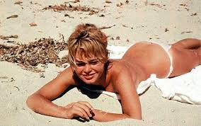 TABOO TO TOPLESS SUNBATHING? THE BARE FACTS