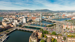 Aerial view on river and buildings in City center of Belfast Northern Ireland. Drone photo
