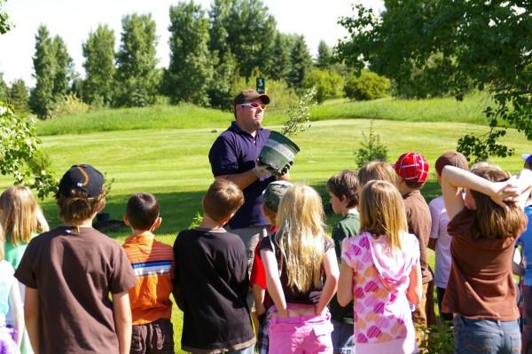Ben Fulkerth showing kids how to plant and establish bird habitat.