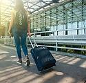 woman strolling at airport.jpeg