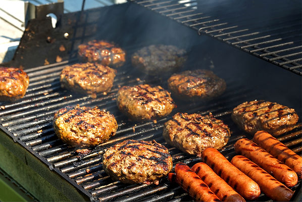 Hamburgers and Hotdogs on the grill from Helga's Catering All American Grill Party Menu