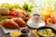 Hot Breakfast Buffet with croissants and eggs from Helga's Catering Corporate Catering Menu
