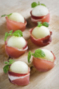 Melon Wrapped Prosciutto from Helga's Catering Italian Romance Wedding Menu