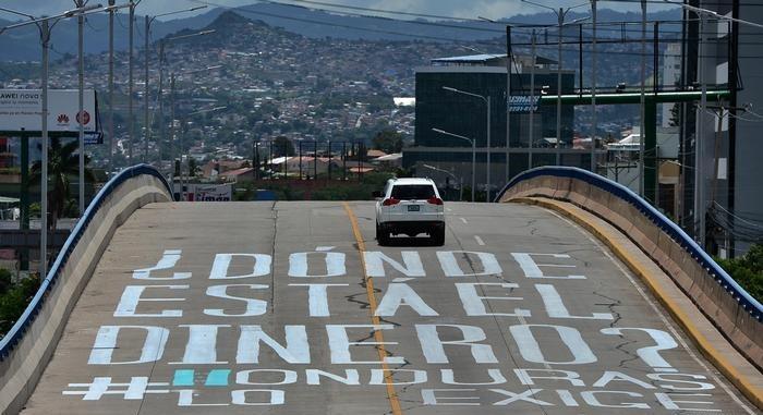 La ciudadanía exige que el Estado rinda cuentas sobre todo el dinero que se ha aprobado en el contexto de la pandemia de Covid-19 - Fotografía de AFP por Orlando Sierra
