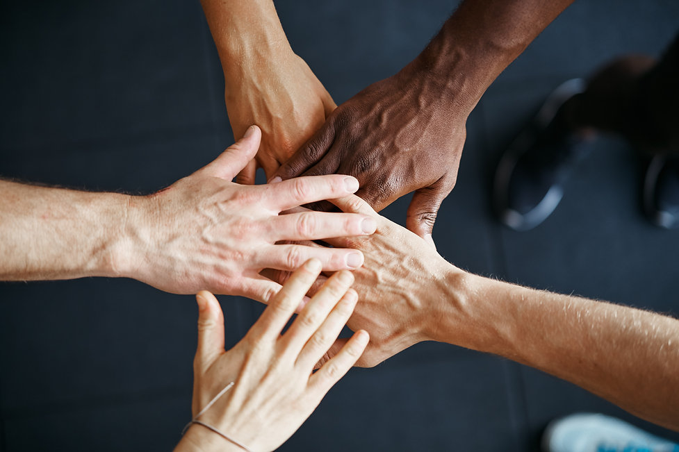 diverse-people-standing-with-their-hands