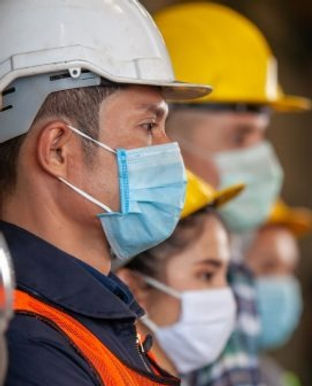 workers-wear-protective-face-masks-for-s
