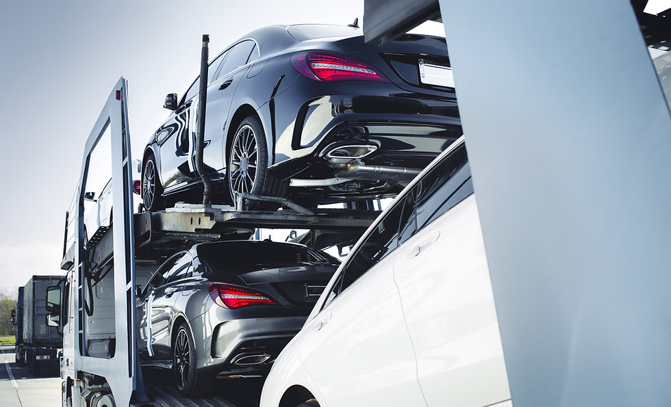 Big car carrier truck of new luxury sport german cars  delivery to dealership . truck of n