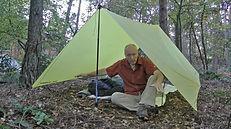 Wilderness guide explaining under a tarp