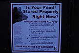 Sign with bear food storage rules in Kings Canyon National Park, USA