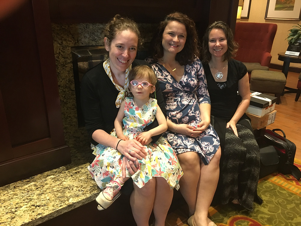 Board President, Jen Koym, her daughter, Lily, and Emma Galin-Attleson and Denise Duclos of Hospitality Homes enjoy their morning together.