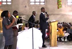 Oberto Elie leading worship