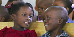 Kids sitting in Ennery Church