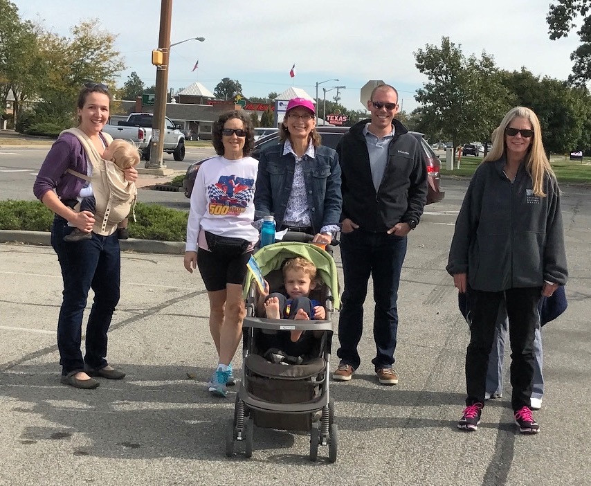 Dr. Kinsey (center, behind stroller) leads a walk on October 14th 2016.