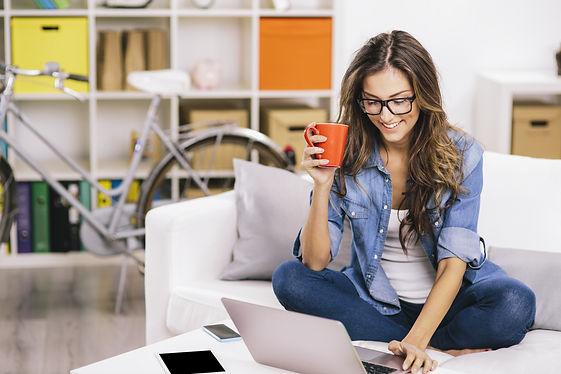 Female orange coffee cup on sofa.jpg