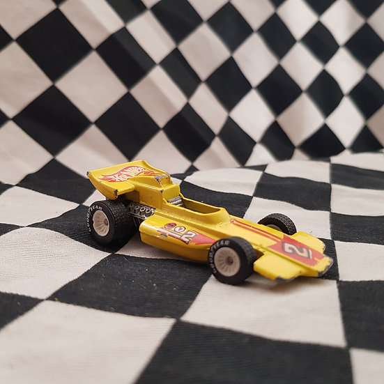 Hot Wheels Lightning Gold Racing Car Real Riders White Hubs Yellow
